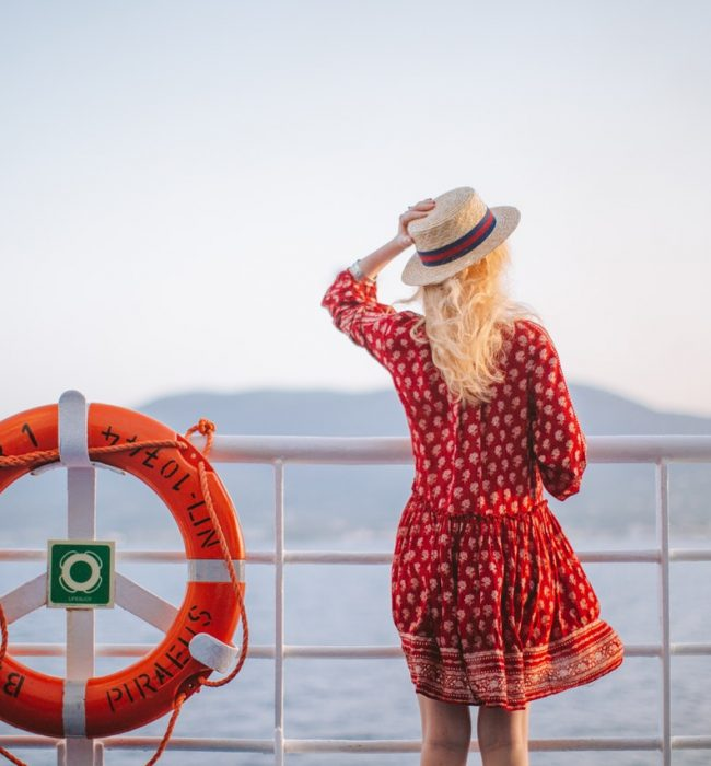 woman-in-red-dress-looking-at-the-sea-4210064